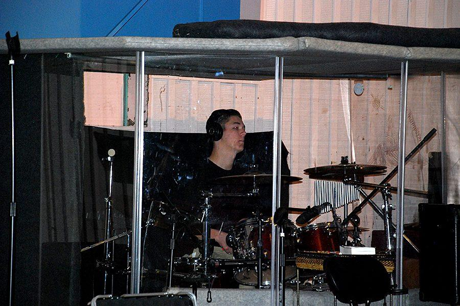 During chapel on February 21, sophomore Hunter Sumner plays the drums during the song,