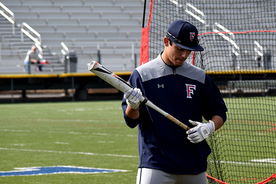 On March 16, Jeremy Wager-Smith takes practice swings before playing Bradshaw Christian High School.