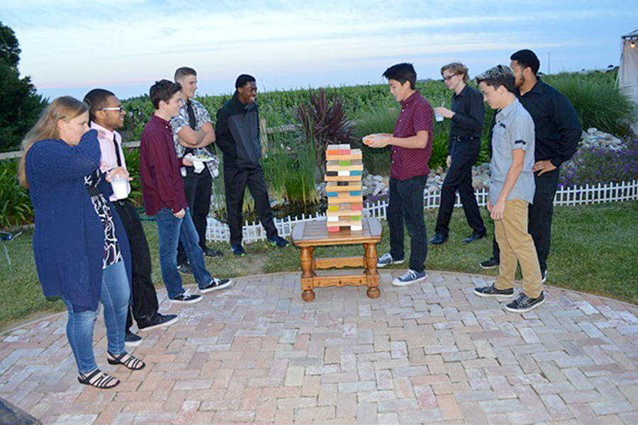 On May 5, juniors and seniors watch as junior Jack Gardner plays the game of Jenga.