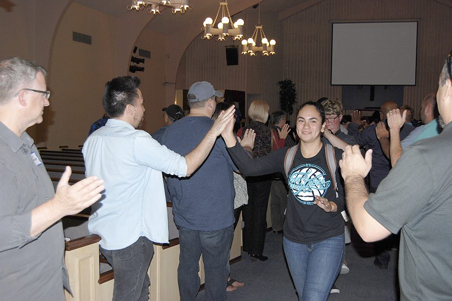 Junior Emma Alvarado high-fives several pastors at the conclusion of Pastor Appreciation Chapel on October 3.