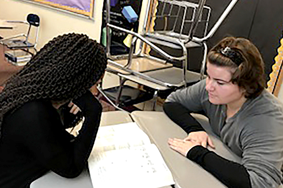 Juniors Alana Benson and Izzy Petrovsky quiz each other in preparation for taking the SAT.