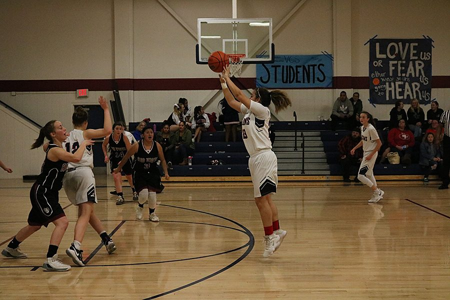 Senior guard Allie Torres shoots the three against Rio Vista High School on January 17. The Falcons won this game, 55-33.