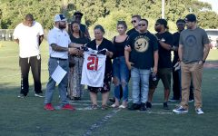 Former VCHS football player Kwaun Strong's mother, Kwana, holds her son's jersey. Coach Kyle Allen, who also coached Kwaun, presented her with the jersey at the first home game on August 30, 2019.