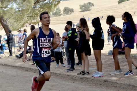 Junior Josh Shelby rounds the loop at the Lagoon Valley Classic Invitational Meet in August. Josh was named League MVP after the Falcons won the SDL championship.