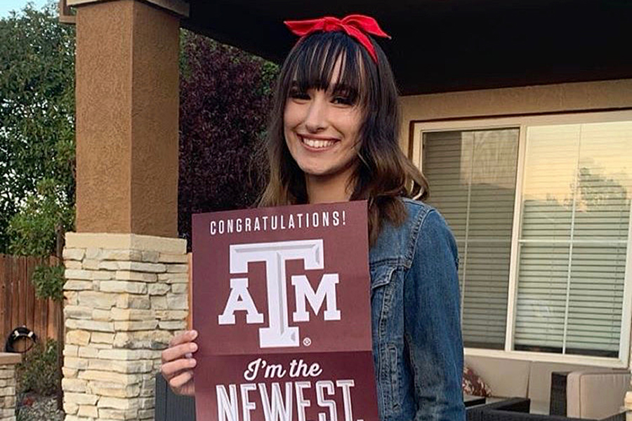Tory Belval holds her acceptance notice from Texas A & M University.