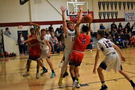 Lukas Hier (11), Houston Bradeson (15) and Gabe Helmer  (24) defend their basket against Highlands on Tuesday, January 14.