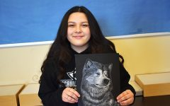 Junior Sam Salas shows us her finished scratchboard project.