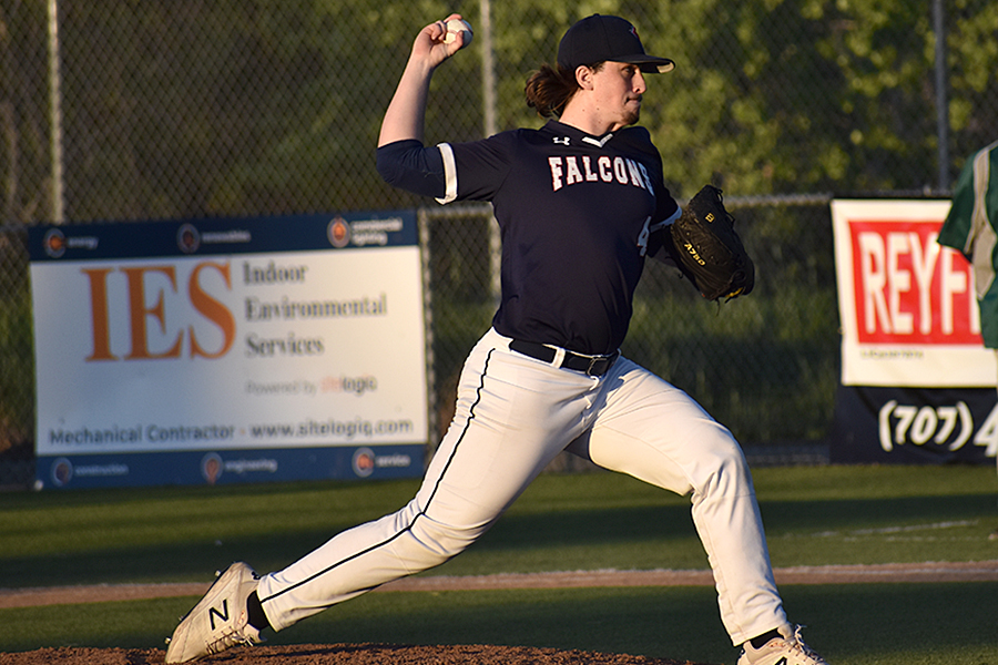 Pitcher Senoir Ian Peixoto throws against Delta Charter Dragons in a 5-1 game, with the falcons taking home the win.