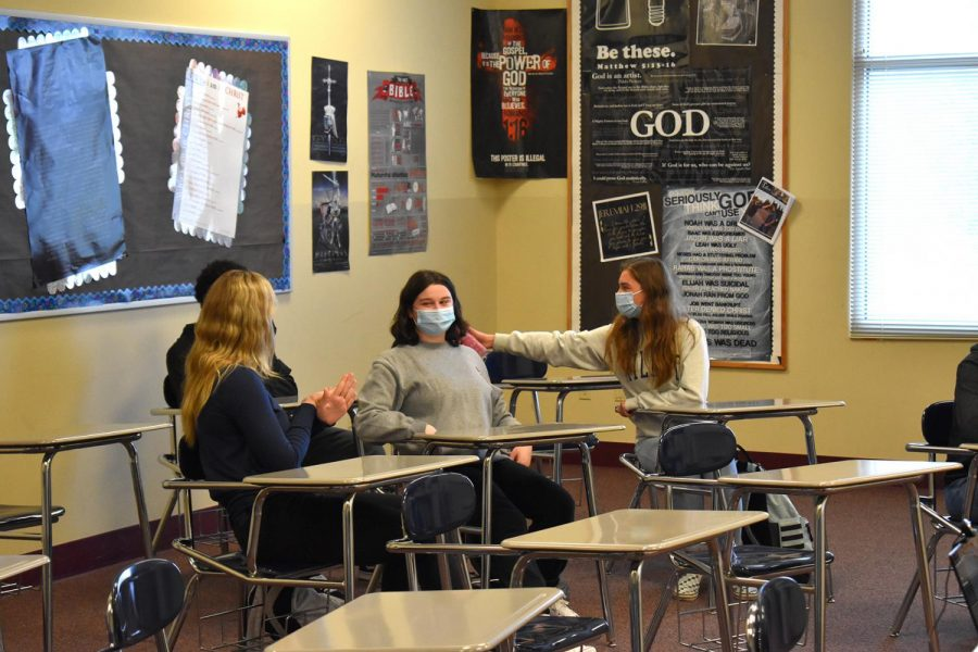 Sophomores Kirra Martin, Kai Nunley, Jordan Holden, and Nakaya Peters talk to each other before there 7th period bible class begins on November 18, 2020.