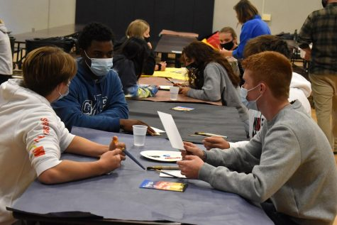 Sophomores Kai Nunely, Wesley Krier, and Hunter Jackson create paintings for chapel to celebrate God