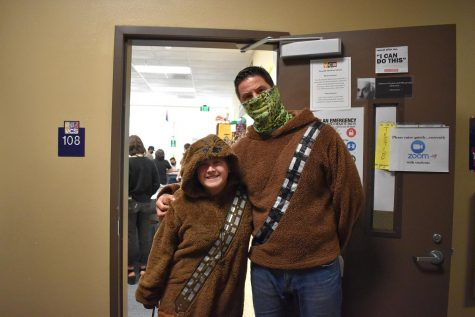 Teacher Mr. David Kuch and freshmen Kyra Williams dress in their Star Wars inspired outfits for the movie themed Spirit Week.