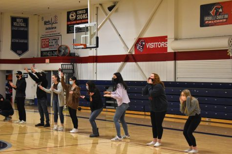 Juniors Chris Lespron, AJ Piehl, Kirra Moore, Kim Miller, Elaina Craig, Kayla Ludwick, Katie Stanek and Annelise Lembrecht participate in the chapel game, Giants Wizards and Elve, in the gym on January 12, 2021.
