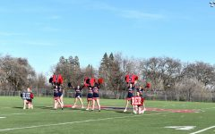 Navigation to Story: Cheer Team Performs