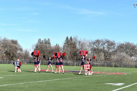 The Cheer Team performs their cheer during the spirit rally on February 4, 2021 on the field.