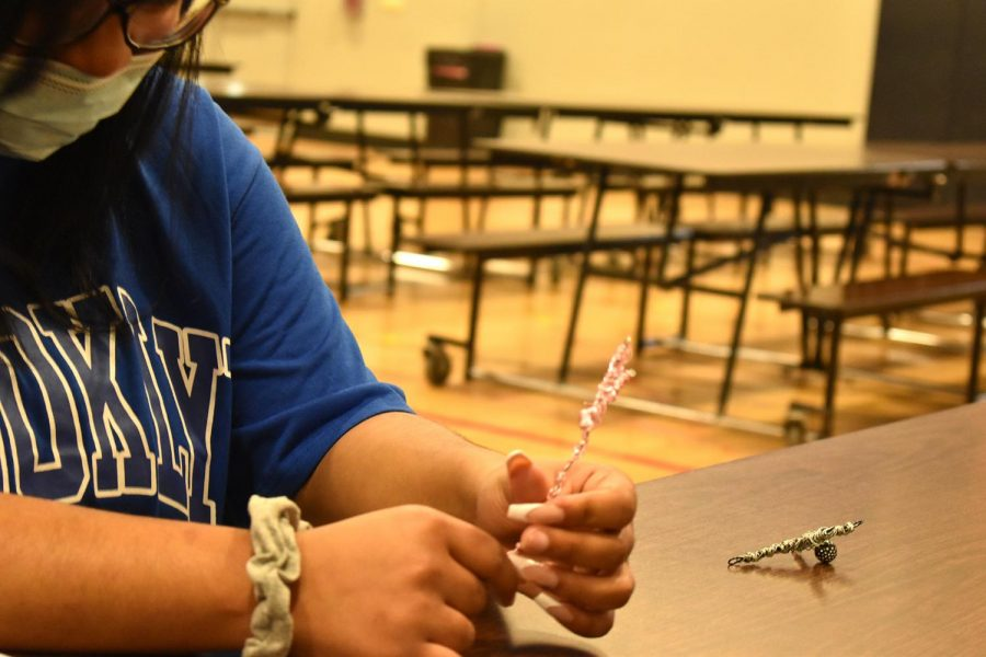 Senior Miyah Harris creates a cross out of metal in chapel on March 2, 2021, in the MP.