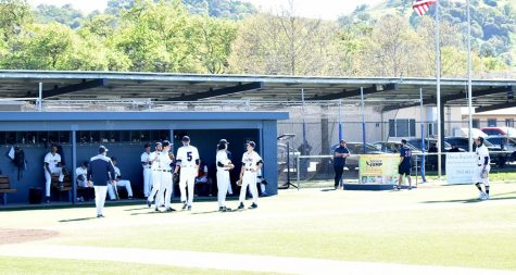 The VCHS baseball team huddles up before their 3rd game of the season against Leroy Green Academy on March 26; Falcons won this game 8-2.