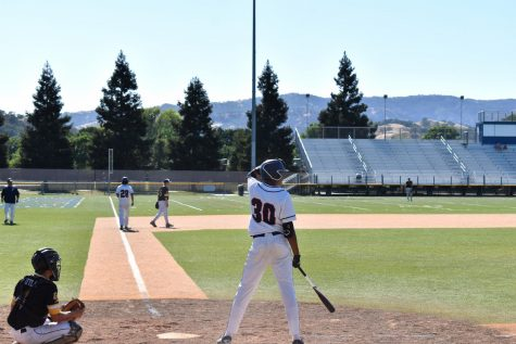 Freshman Larry Lewis waits on the next pitch during the Falcons final game of the season against Golden Sierra.