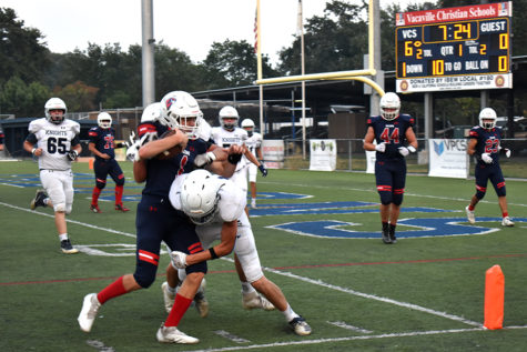 Quarter Back #1 Hunter Jackson trys to run for a touchdown but is tackled right before he can score.