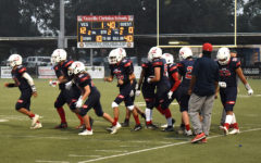 Navigation to Story: Football Falcons Come Out Of A Huddle