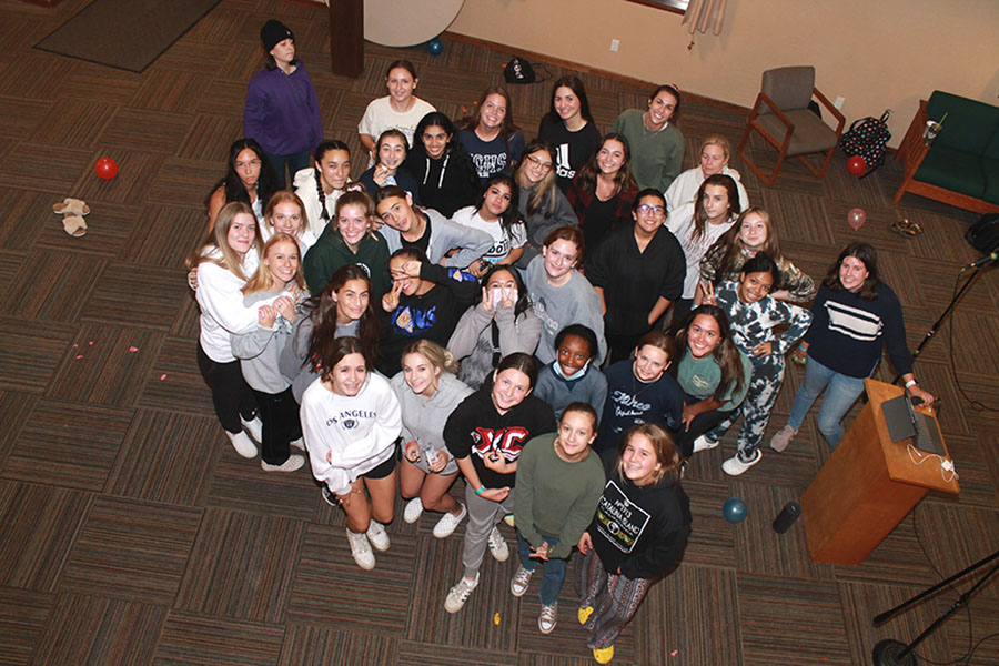 The freshmen and senior girls take a break from karaoke to pose for a picture.